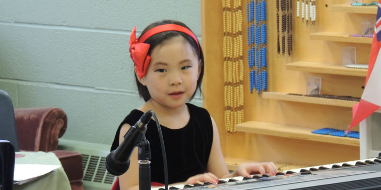 Montessori Child Playing Piano